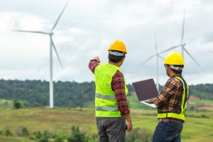 Two Windmill engineers monitoring a construction site